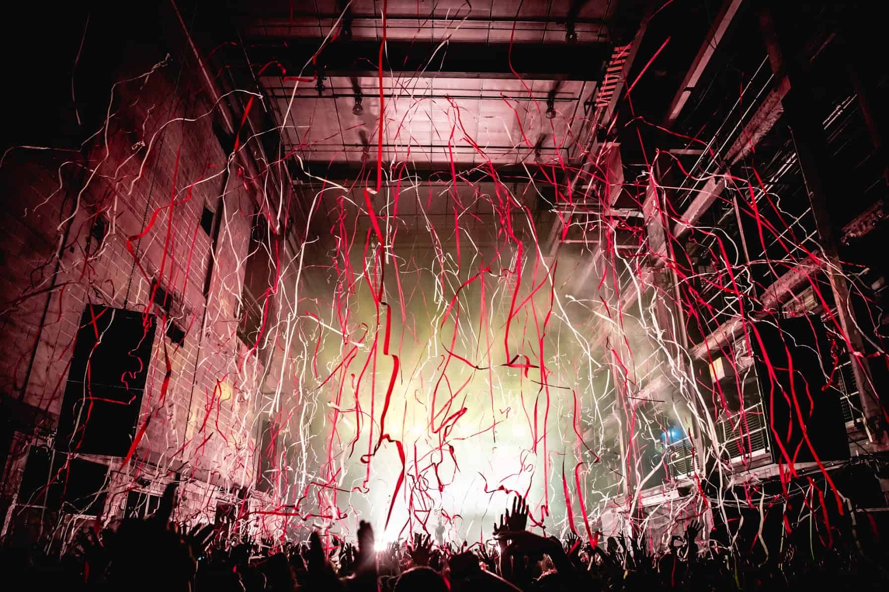 Display of Special FX at the Printworks in London with streams of coloured paper dropping from the ceiling